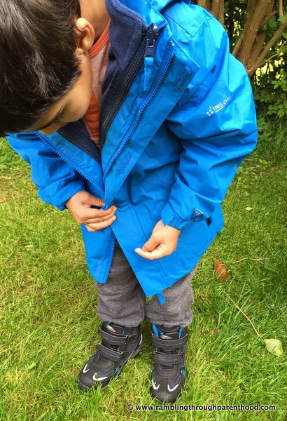 J models his new Sulivan Boy's 3 in 1 Waterproof Jacket by Trespass