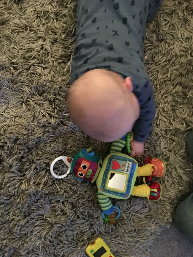 baby-on-carpet-with-lamaze-robot-toy
