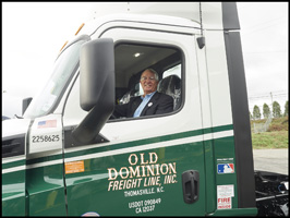 David Congdon, CEO and vice chairman of the board for Old Dominion Freight Line, drives Old Dominion's 15,000th Freightliner truck off the assembly line