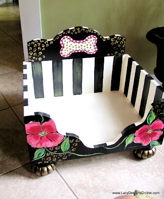 hand painted dog bed with black and white stripes, flowers and animal print