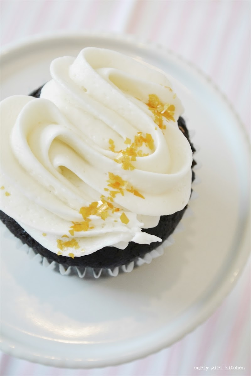 Chocolate cupcake with buttercream and gold sparkle