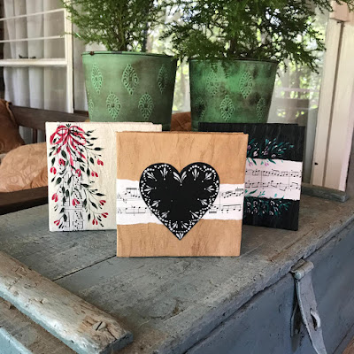 3 different cards featuring strips of music sheets and painted using folk art brushstrokes.