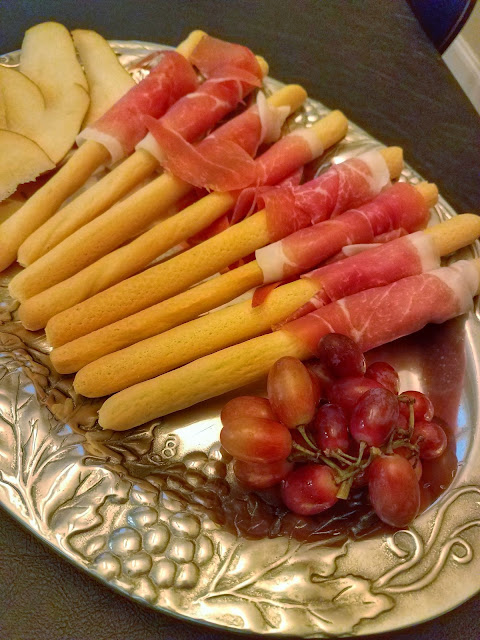 Italian prosciutto wrapped around breadsticks can be put together within minutes for party