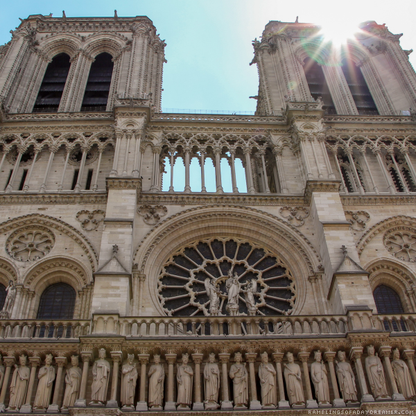 Exterior shot of Notre Dame Cathedral in Paris France in the sunshine
