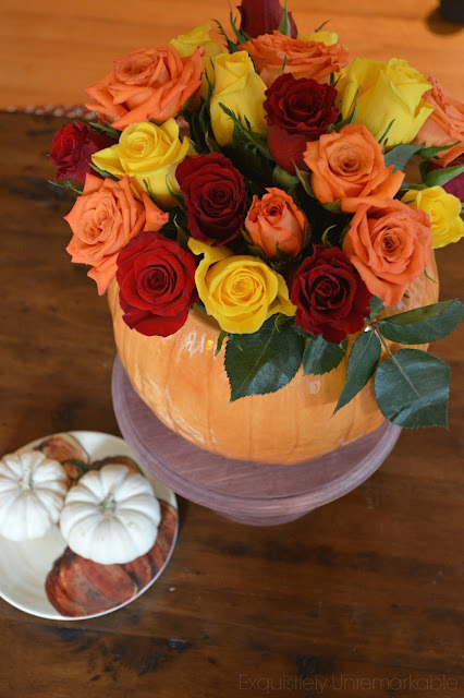 DIY Pumpkin Vase For Fall with roses and baby pumpkins