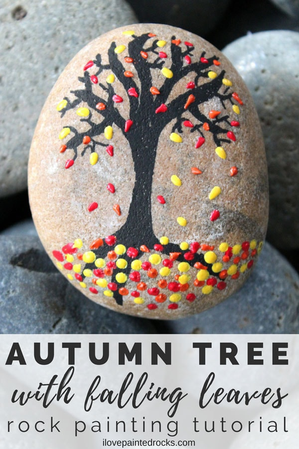 What a cool fall rock painting idea. Using 3D paint makes it easy to make the leaves on this beautiful tree painted rock. #ilovepaintedrocks #rockpainting #PaintedRockIdeas #paintedrocks #paintrock #kindnessrocks #paintedstone #rockart #stoneart #paintedstoneideas #crafts #rockcrafts #fall #fallcraft #fallpainting