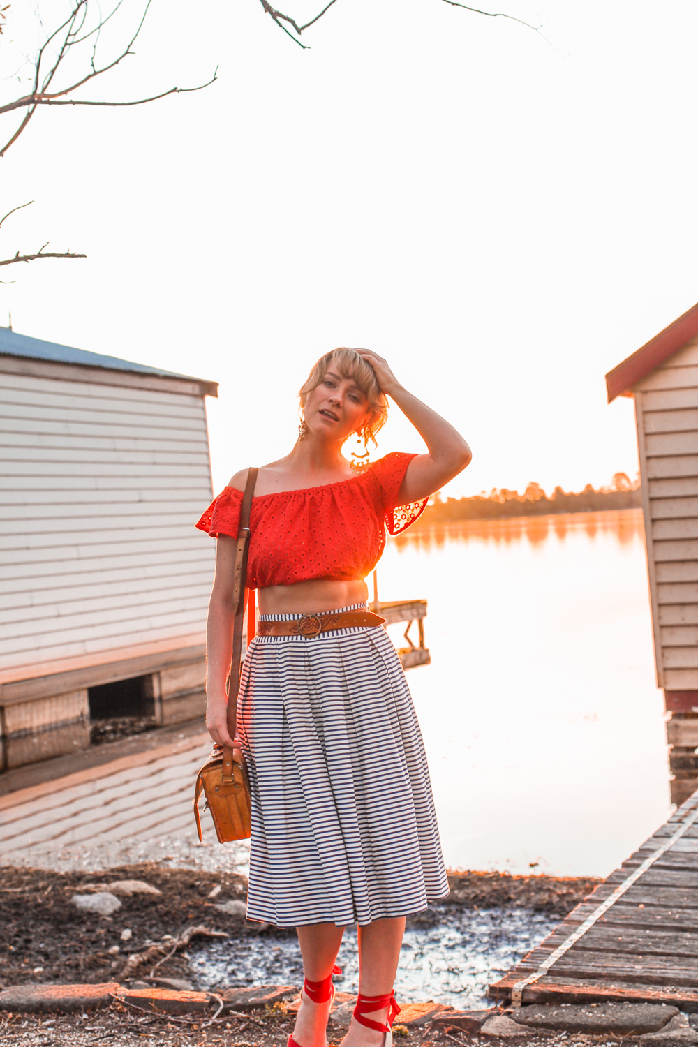 Liana of @findingfemme in Ballarat wearing ASOS cropped red lace top and striped skirt