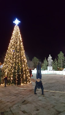 "Plaza Hristo Botev, ice skating, and two pinos  (pino is Spanish for ""pine tree"" and ""handstand"")"