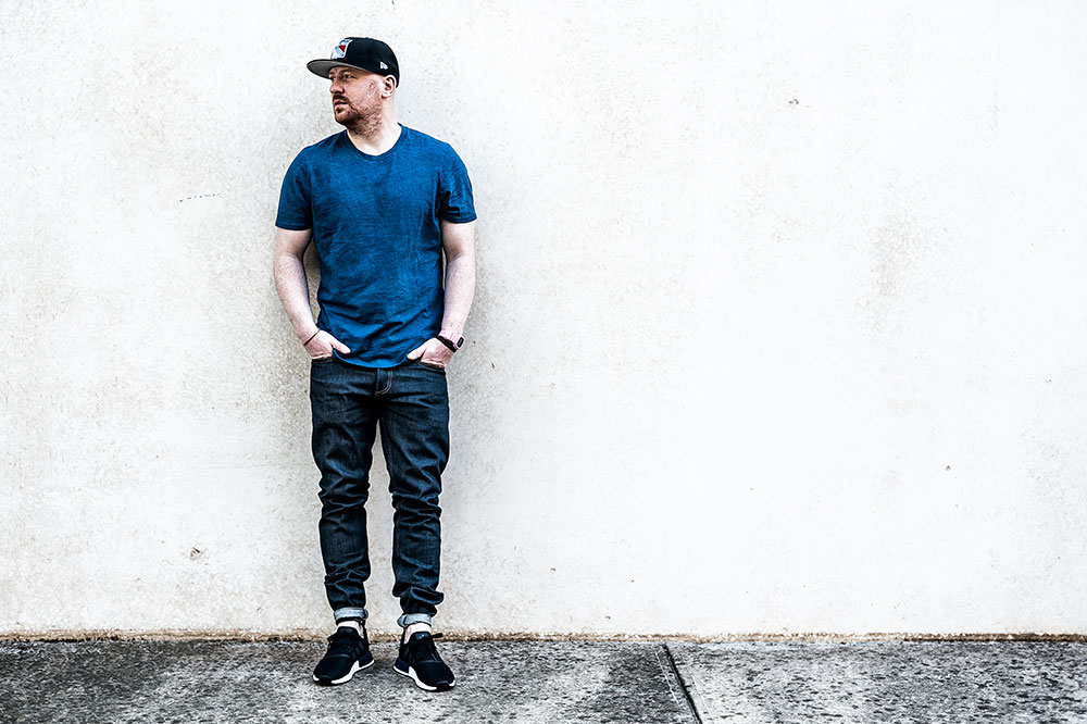 JD Sports X Adidas Originals NMD R1 Black Sneakers / Denham The Jeanmaker Razor VIS Raw Selvedge Denim / Denham The Jeanmaker Signature Crew Indigo Tee by Tom Cunningham