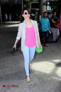 Tamanna Bhatia Spotted at International Airport in Denim Jeans and Pink Top