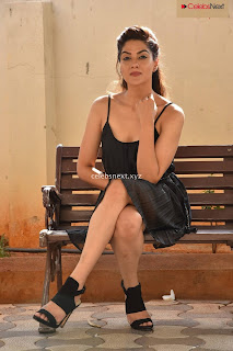 Sakshi Choudhary in Sleeveless Deep Neck Short Black Dress Stunning Beauty .XYZ Exclusive