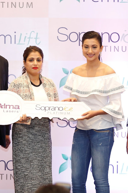 Actress Gauhar Khan handing over the keys of Soprano Ice to Mrs Jharna Dhar, General Manager, ISAAC