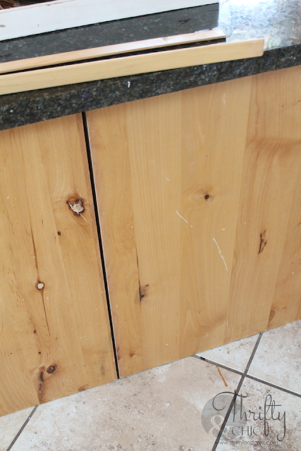 Board and batten kitchen island makeover. How to update your kitchen island. DIY kitchen island update. Two toned kitchen cabinets. White and wood kitchen cabinet ideas. Knotty alder kitchen cabinets.