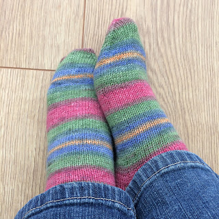 Photograph of a pair of hand-knit socks
