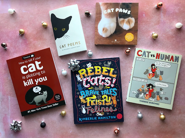 a selection of books and comics about cats
