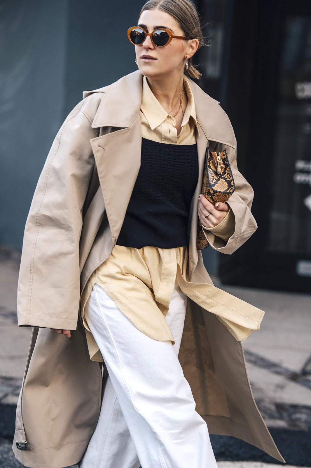 The Street Style Way to Wear Layers This Season — Minimalist Scandi Outfit — Orange Oval Sunglasses, Trench Coat, Button-Down, Snakeskin Bag, Tank Top, and White Pants
