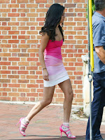 Selena Gomez shows lean legs and ample cleavage in a pink bandage dress