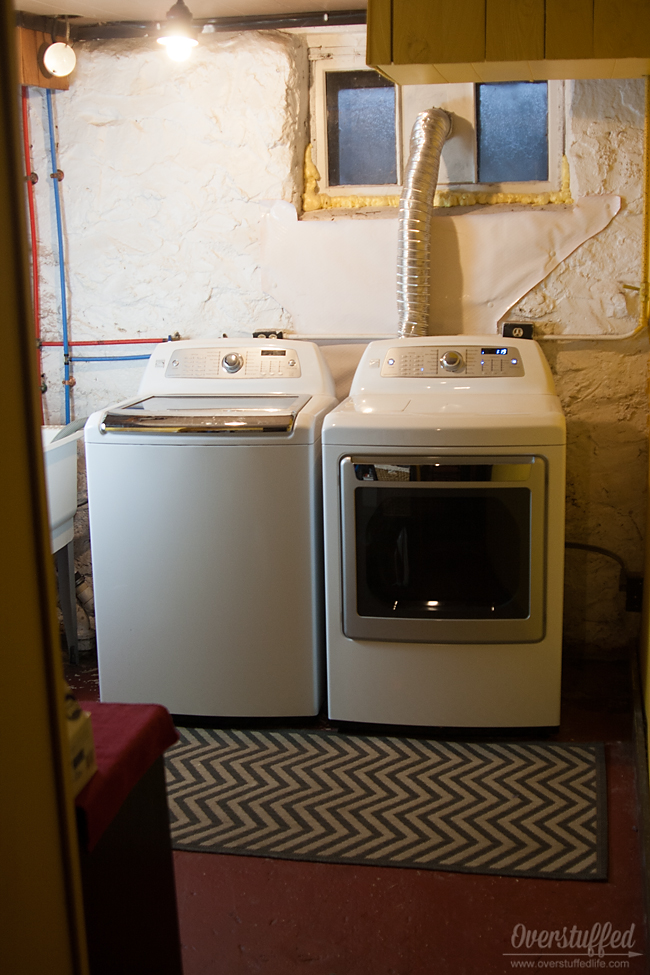 Putting a rug in front of your washer and dryer in a basement laundry room is helpful