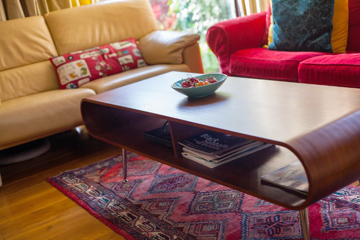 MADE hooper coffee table, yellow leather couch, persian rug