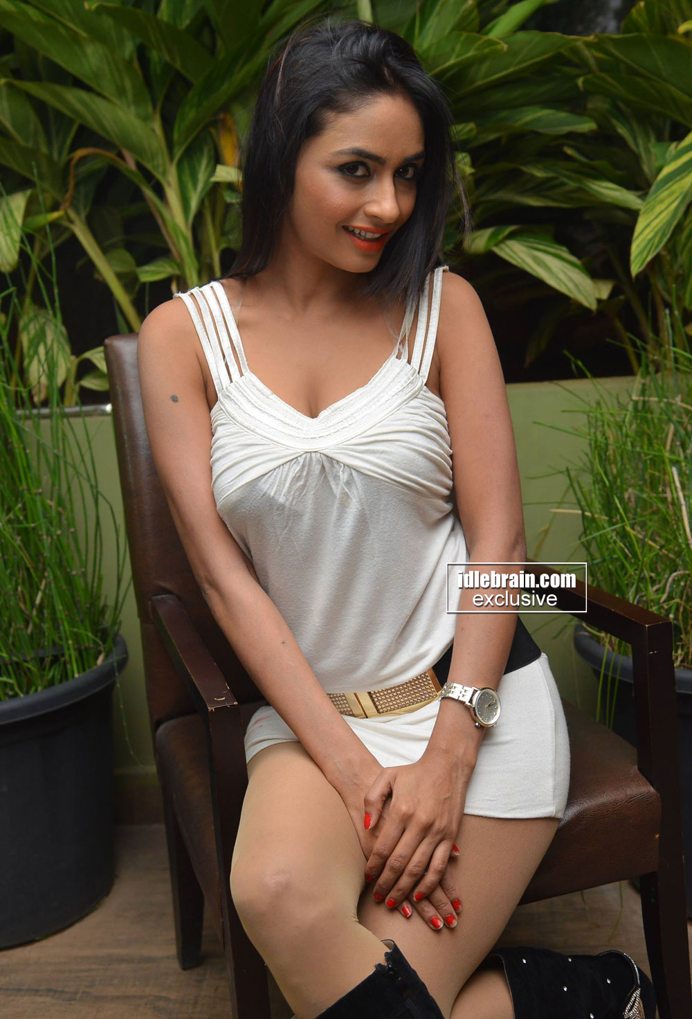 Pooja Sri in a Deep Neck Sleeveless short dress spicy Pics