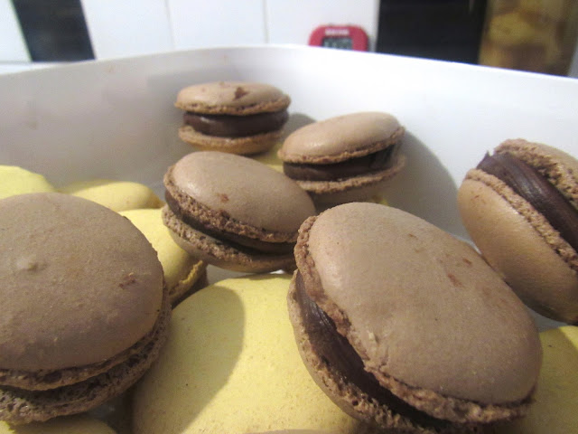 Chocolate Macarons with chocolate ganache and raspberry jam