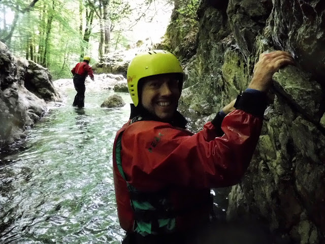 Clinging on for the rock wall challenge - Canyoneering in Coniston