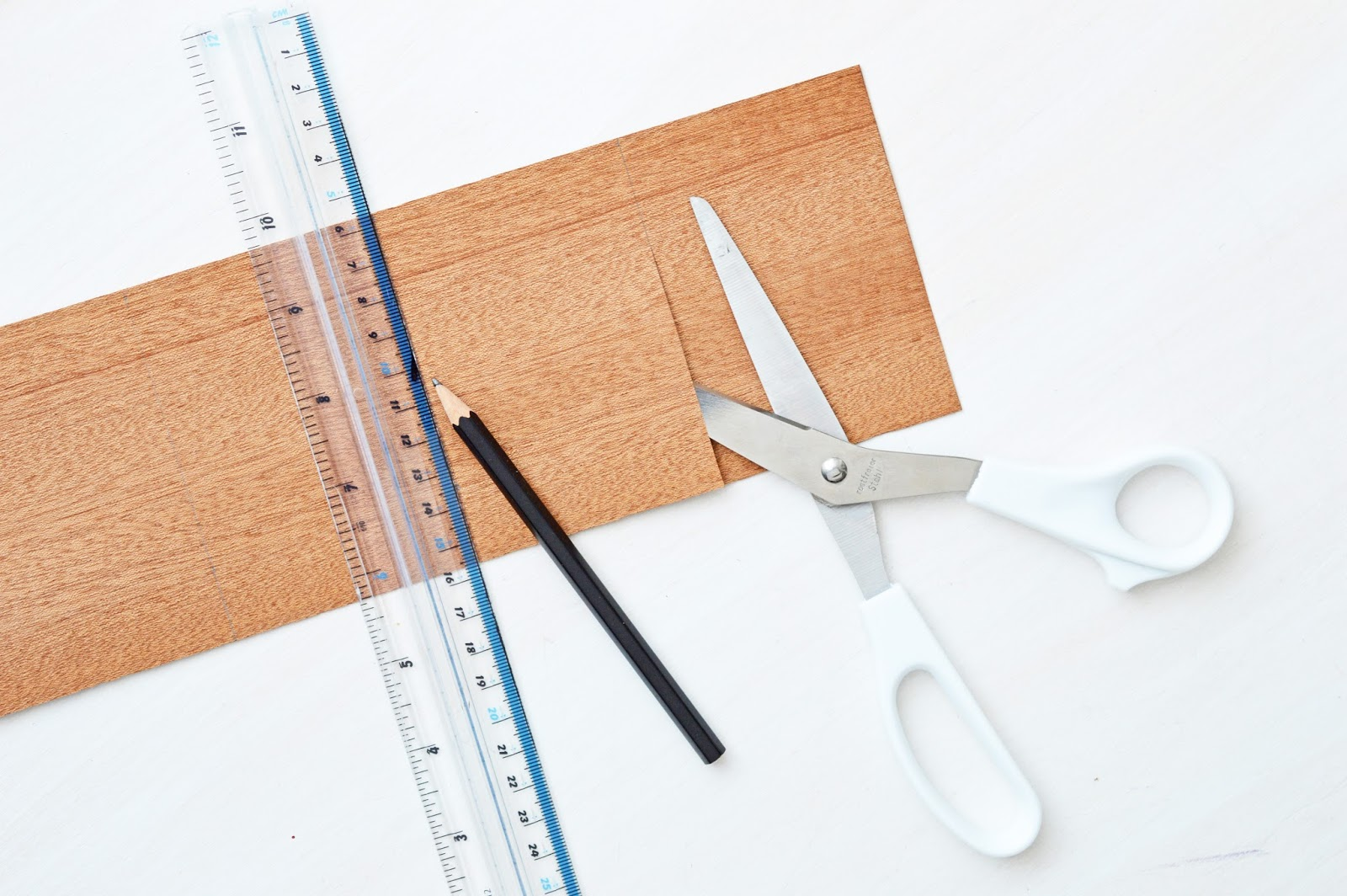 cutting up a veneer leaf for a DIY letter board