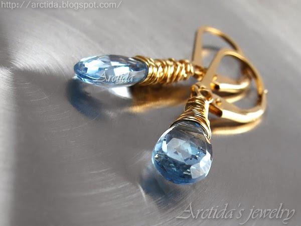 http://www.arctida.com/en/minimalism/22-blue-topaz-earrings-wire-wrapped-14k-gold-filled-nimue.html