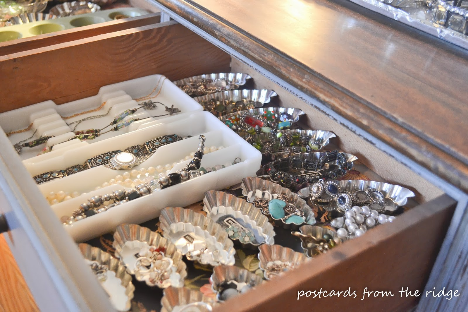 Vintage tart tins, dental trays, and other items repurposed for jewelry organization.  Very clever!