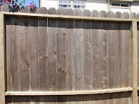 Photo of a weathered gray fence.