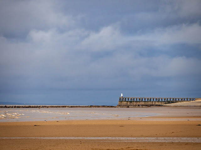 Photo of blue sky and light cloud over the beach at Maryport on Monday afternoon