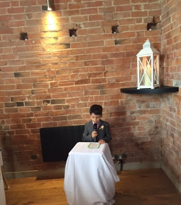 Child doing a reading at a wedding