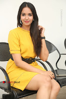 Actress Poojitha Stills in Yellow Short Dress at Darshakudu Movie Teaser Launch .COM 0261.JPG