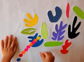 child sticking on stickers onto Matisse Murals