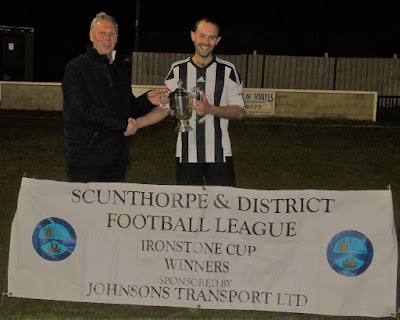 Neil Johnson of sponsors Johnson's Transport Ltd presenting the victorious Briggensians captain Jason North with the Ironstone Cup - April 2019