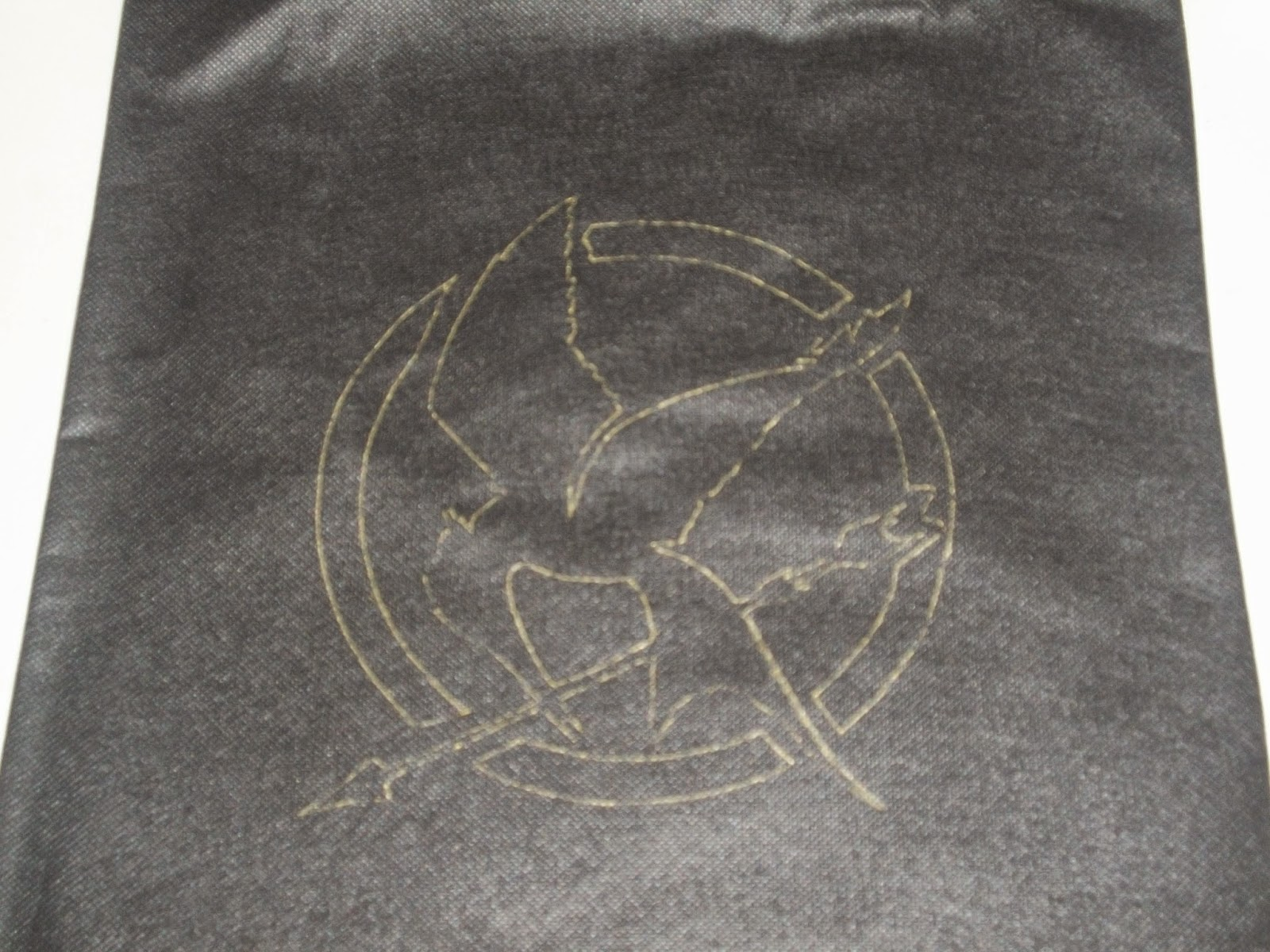 Mockingjay traced onto tote bag