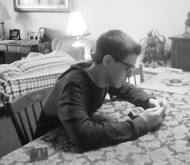 teenager playing cards