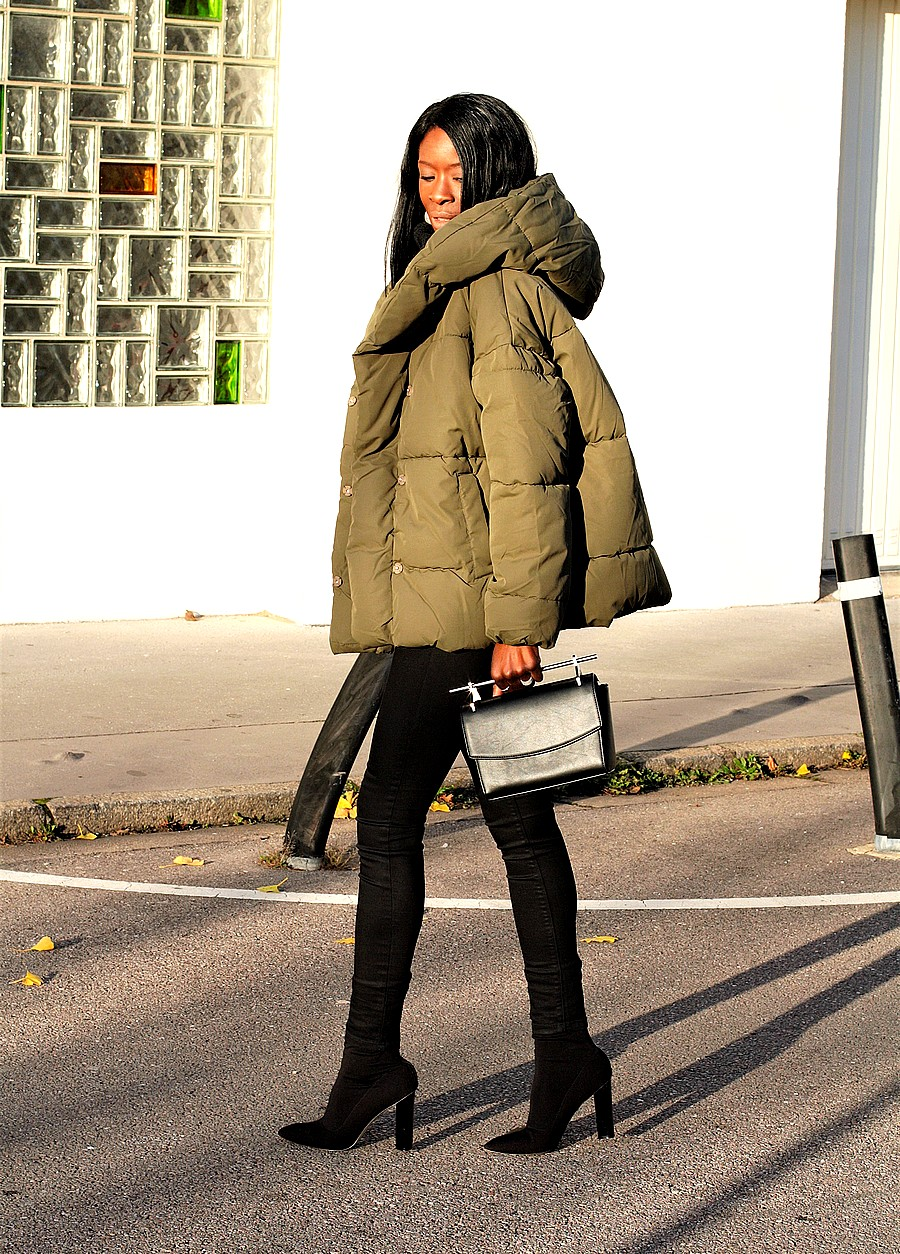 style-blogger-rocking-puffy-jacket-sock-boots-fashion-trend-2017