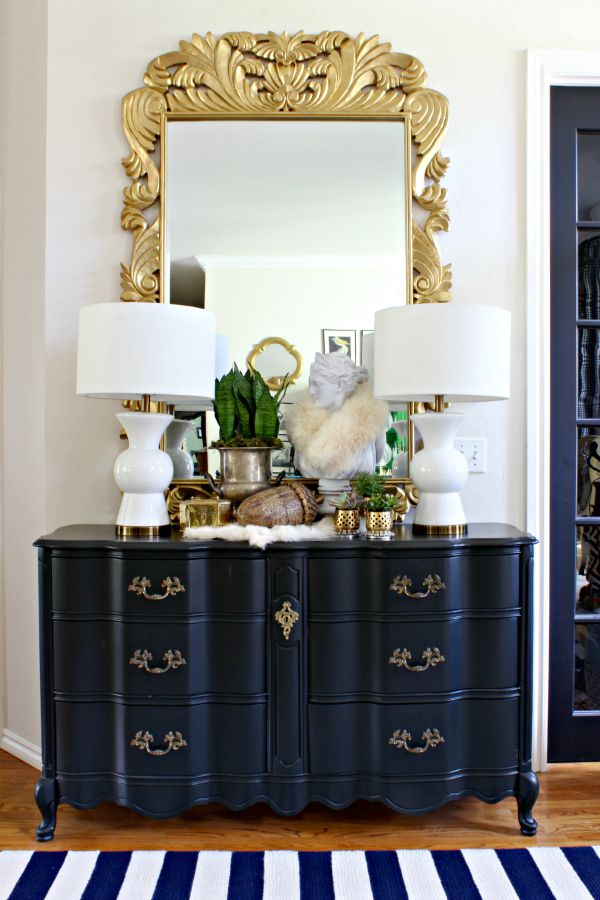 entry, foyer, black french provincial dresser, bust, succulents, white lamps, ornate gold mirror