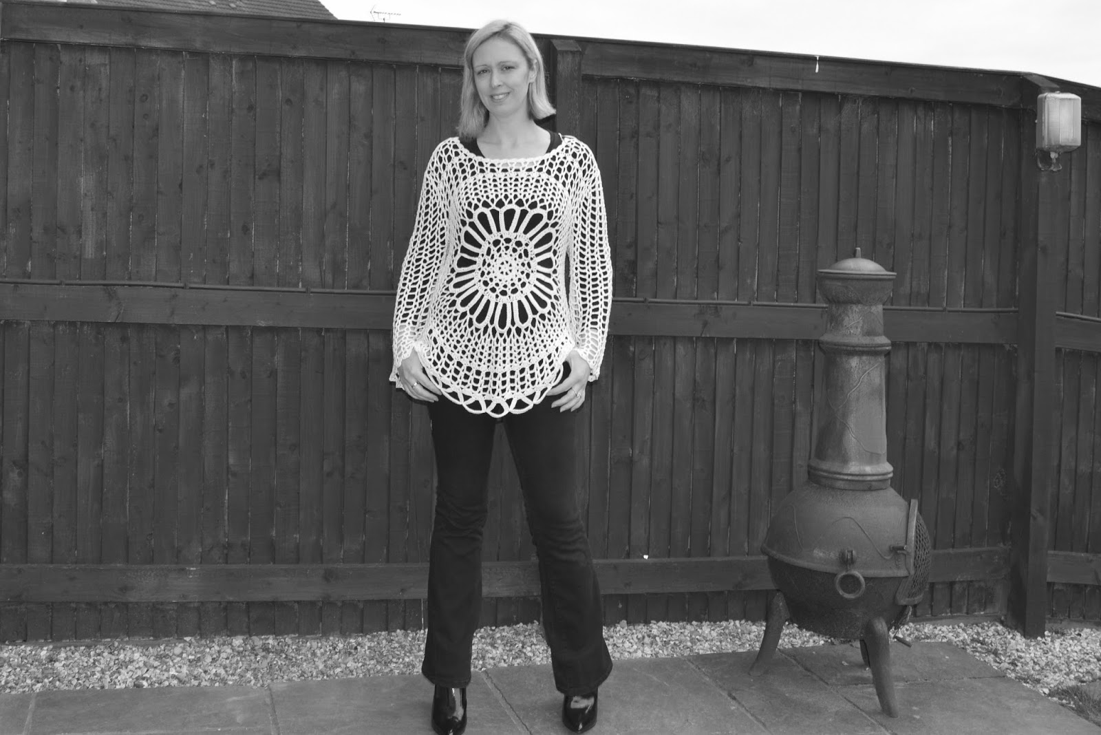 White Lacy Knitted Top, Black Jeans And Heeled Boots