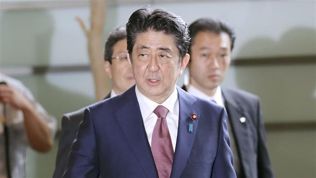 Japanese Prime Minister Shinzo Abe revamps cabinet amid declining popularity over scandals