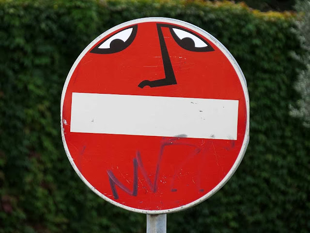 Clet Abrahams, taped mouth with eyes on a no-entry sign, piazza Manin, Livorno