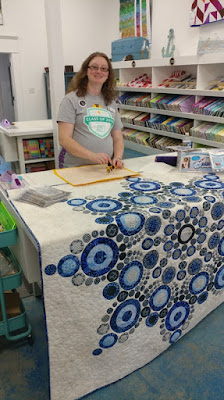 Laura of Slice of Pi Quilts doing a demo of her Flurry quilt pattern