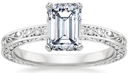 Emerald-cut diamond engagement in an 18K white gold delicate antique scroll setting.