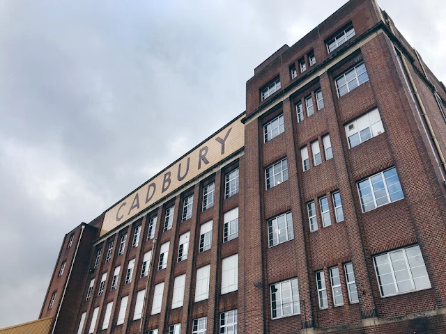 Exterior shot of an old factory with the words cadbury on its frontage