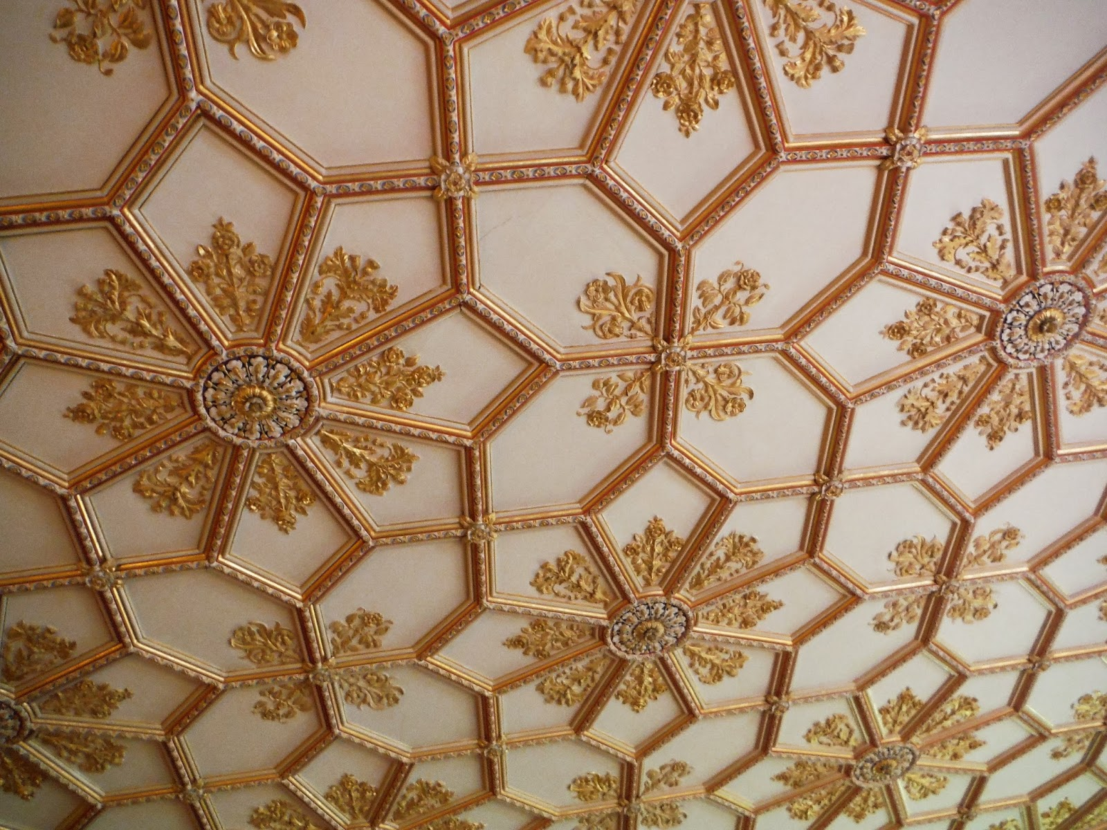 an intricate ceiling inside the main house at Charlecote Park