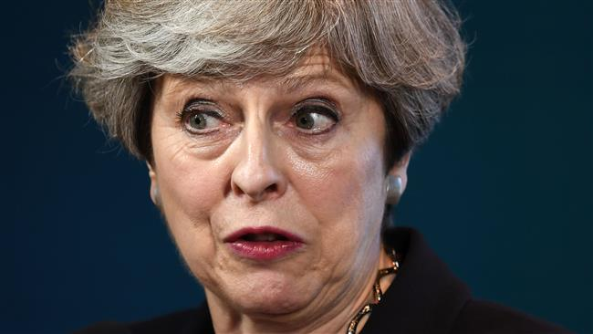 UK polls show British Prime Minister Theresa May's lead over Labor Party cut in half after terror attack