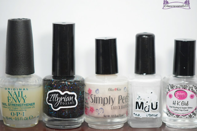 O.P.I Original Nail Envy, Illyrian Polish Orion Nebula, Bliss Kiss Simply Peel Latex Barrier, Mundo De Unas White, Glisten & Glow HK Girl Fast Drying Top Coat