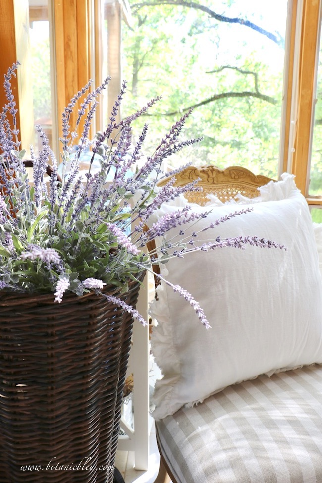 Faux French lavender in a French market basket inside looks like growing lavender in the outside garden
