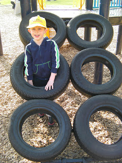 sloping car tyres construction climbing obstacle in playpark